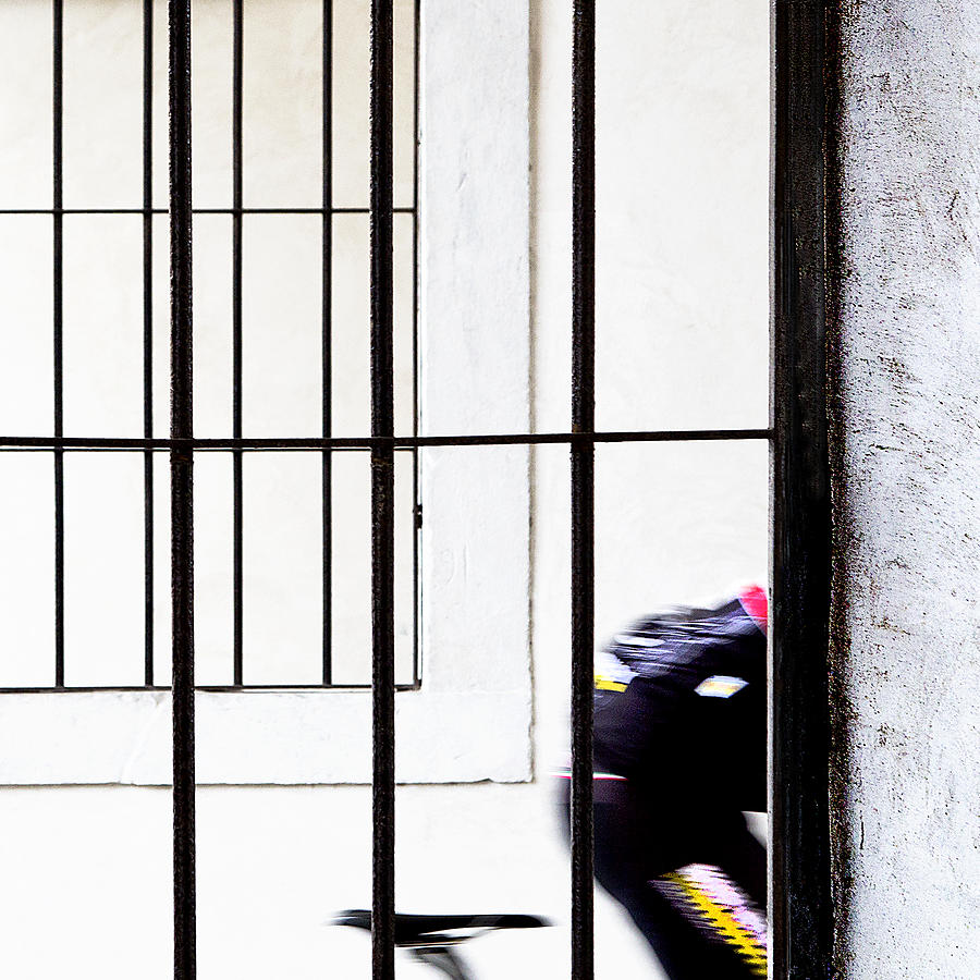 Action Photograph - Cyclist In Black, Yellow, White And Red by Franco Maffei