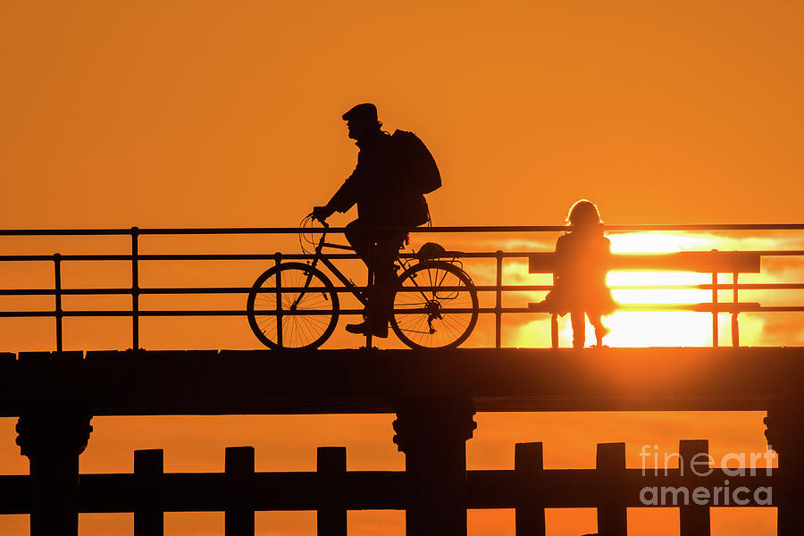 Silhouette Photograph - Cyclist Silhouetted At Sunset by Keith Morris