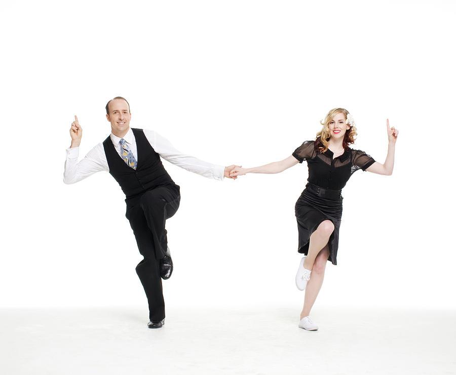 Dance Couple Doing A Lindyhop Dance Move Photograph by Allison Michael Orenstein