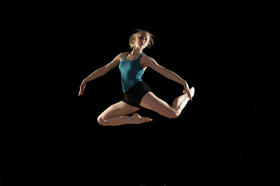 Dancer Jumping On Black Background Photograph by Phil Payne Photography