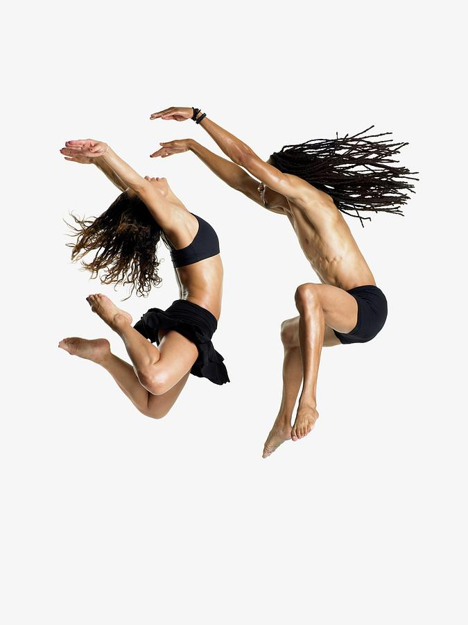 Dancers Jumping Photograph by Image Source