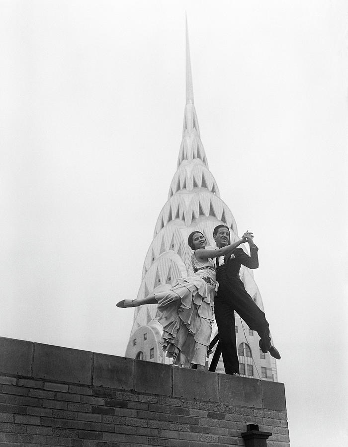 Dancing By The Chrysler Building Photograph by Bettmann