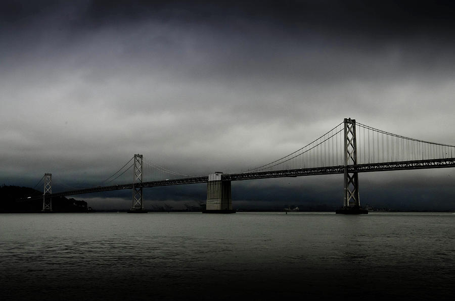 Dark Clouds Over Bay Bridge Photograph by Image Courtesy Of Sean Go