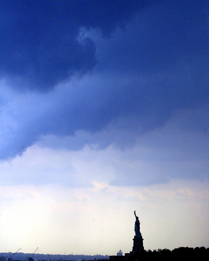 Dark Clouds Roll Towards The Statue Of Photograph by New York Daily News Archive