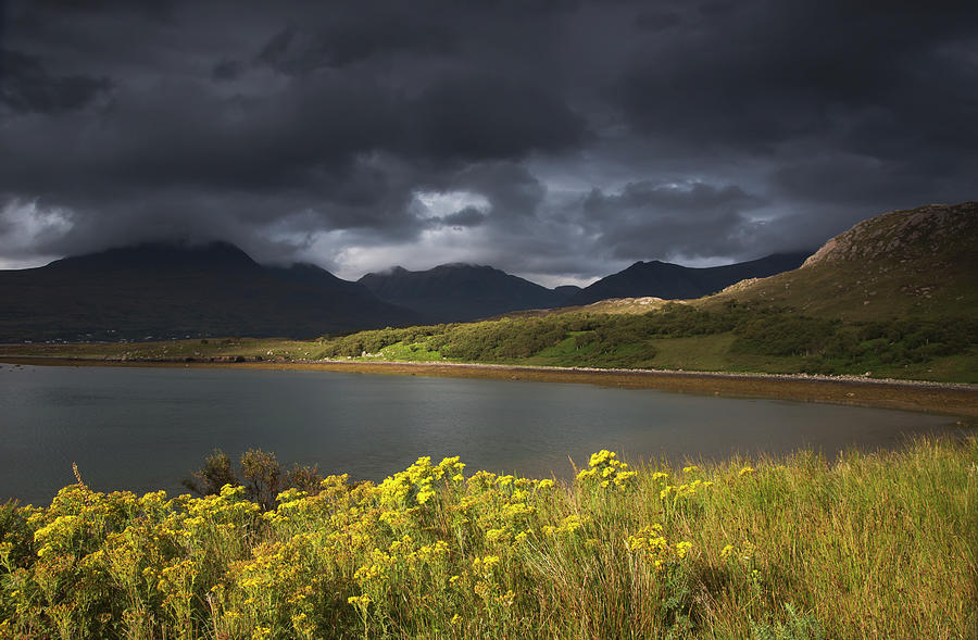 Dark Storm Clouds Hang Over The Photograph by John Short / Design Pics