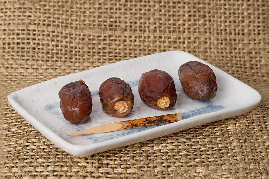 Dates On A Ceramic Plate Photograph by Paolo Negri