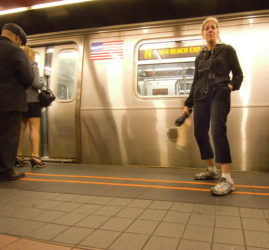 Deborah waiting for the subway train by Ron Brown Photography