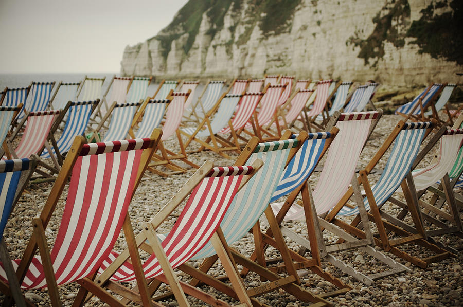 Deck Chairs On Empty Beach Photograph by Alison Wooder