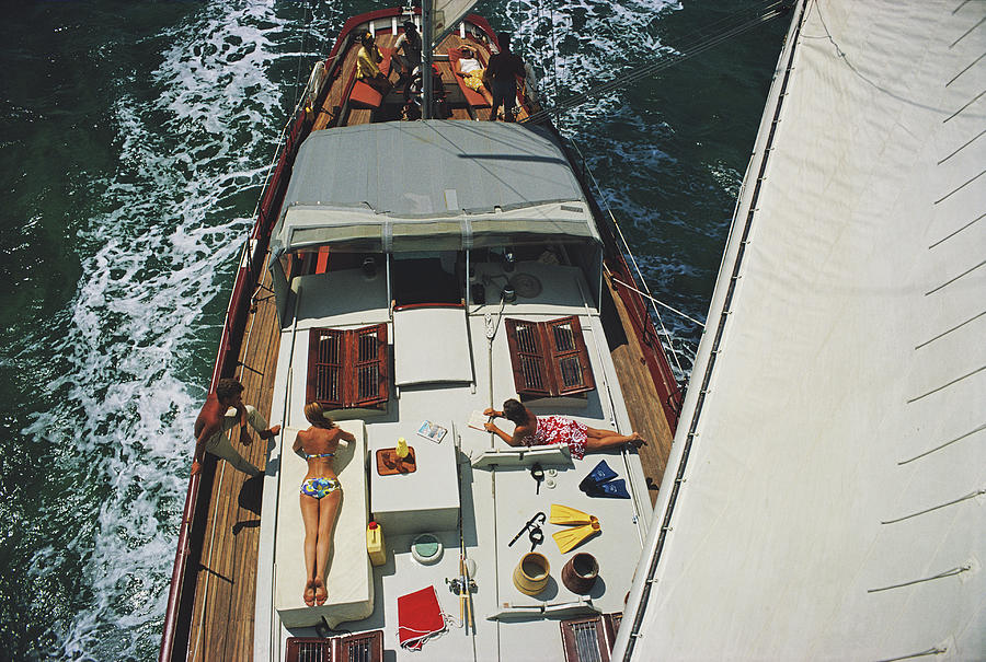 Sunbathing Photograph - Deck Dwellers by Slim Aarons