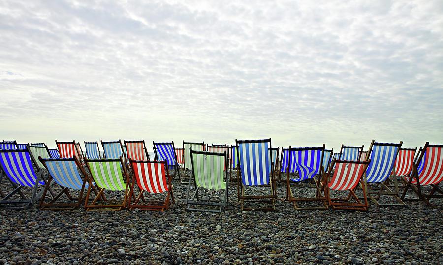 Deckchairs On Beach Photograph by Gagilas Photo