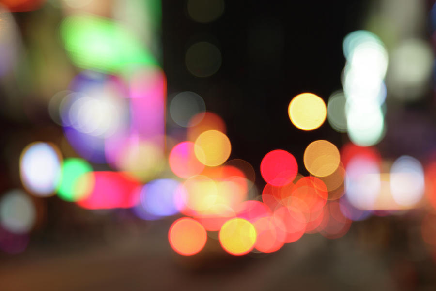 Defocused Light Dots At Times Square In Photograph by Sebastian-julian