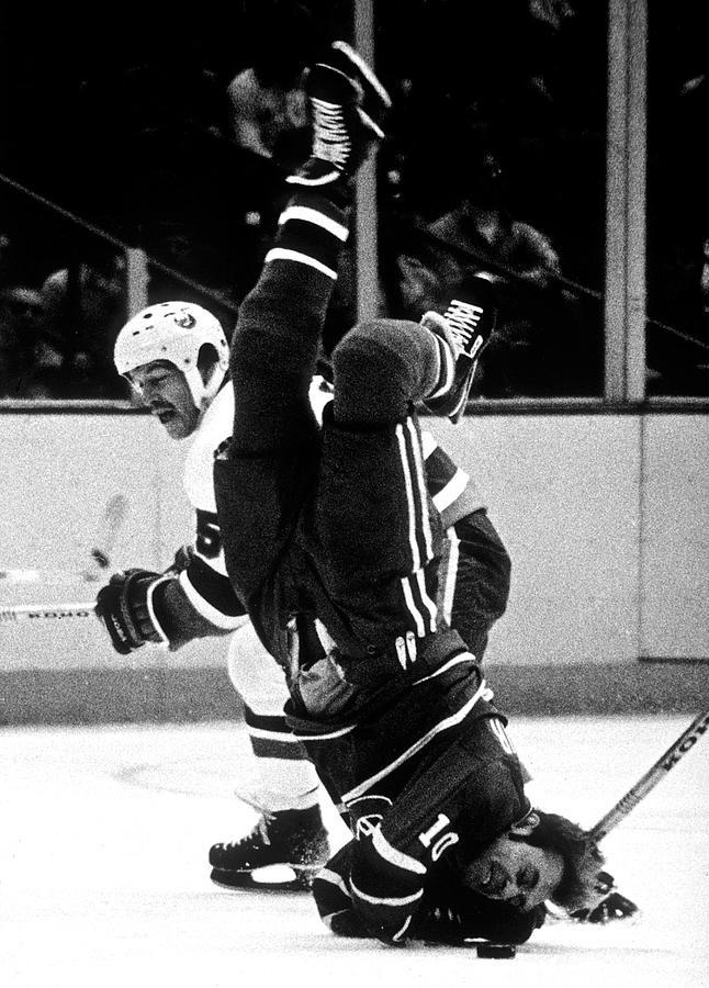 Denis Potvin Hits Guy Lafleur On The Ice Photograph by B Bennett