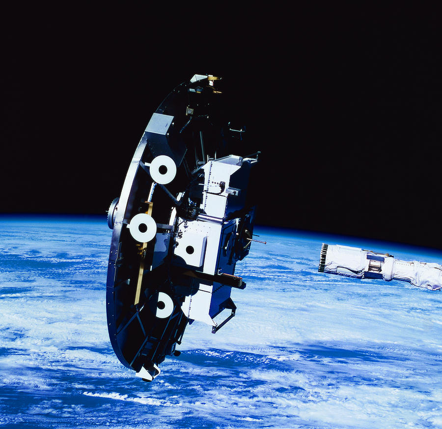 Deployment Of A Satellite In Space Photograph by Stockbyte