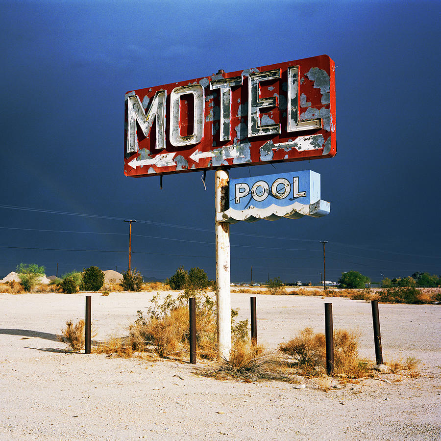 Derelict Motel Sign In The Desert Photograph by Gary Yeowell