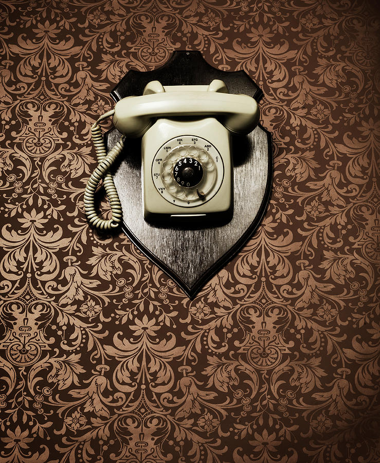 Desk Telephone Hanging As A Trophy On A Photograph by Henrik Sorensen