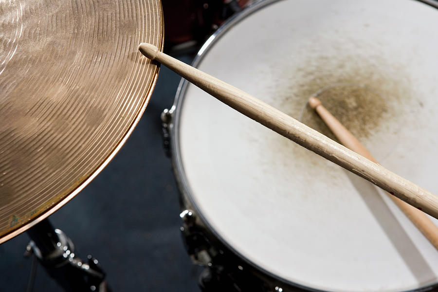 Detail Of Drumsticks And A Drum Kit Photograph by Antenna