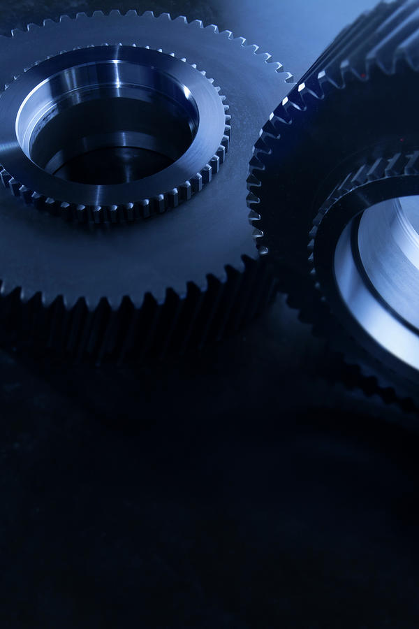 Detail Of Matching Gears In Blue Photograph by Caracterdesign
