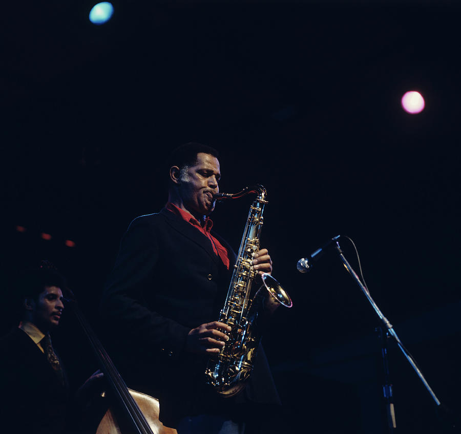 Concert Photograph - Dexter Gordon Performs On Stage by David Redfern
