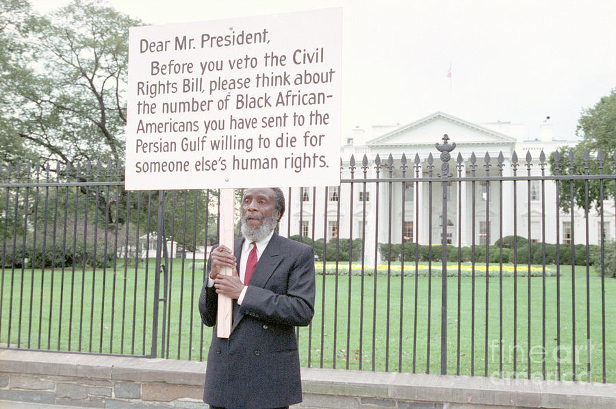 Dick Gregory Holding Placard Photograph by Bettmann