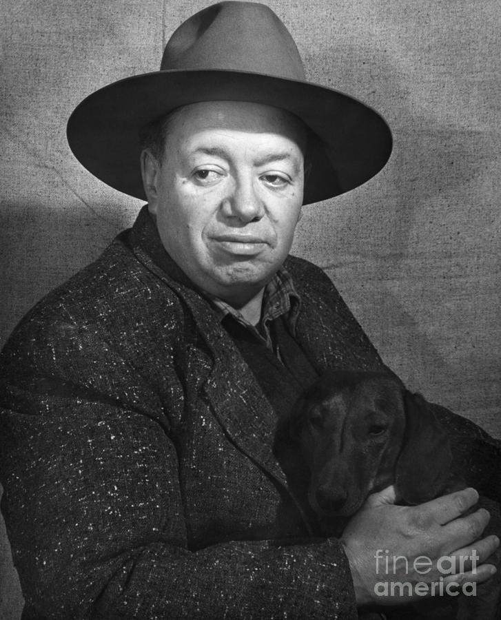 Diego Rivera Holding Dachshund Photograph by Bettmann