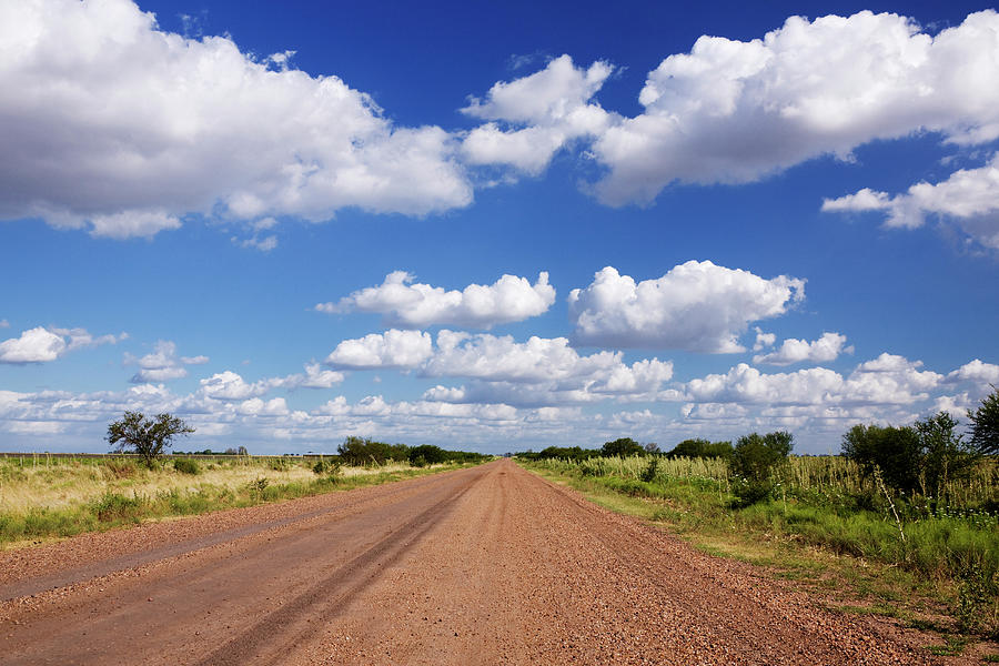 Dirt Road And Puffy Clouds Photograph by Jeremy Woodhouse