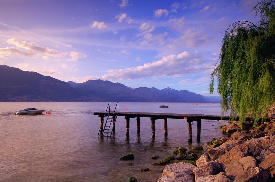Dock And Boat On Lake, Lago Di Garda Photograph by Radius Images