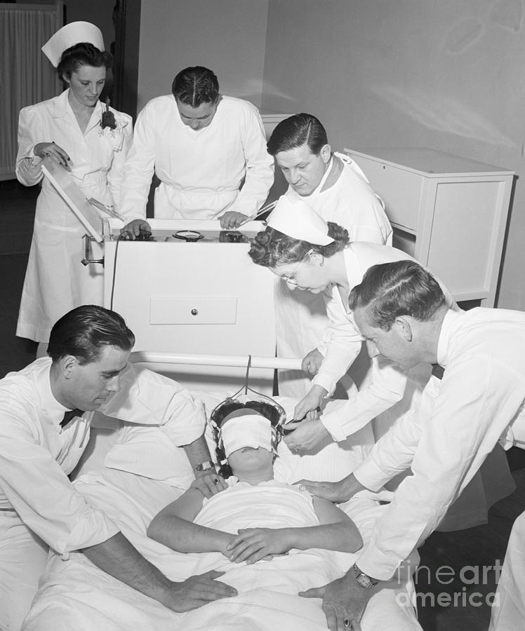 Doctors Administering Electroshock Photograph by Bettmann