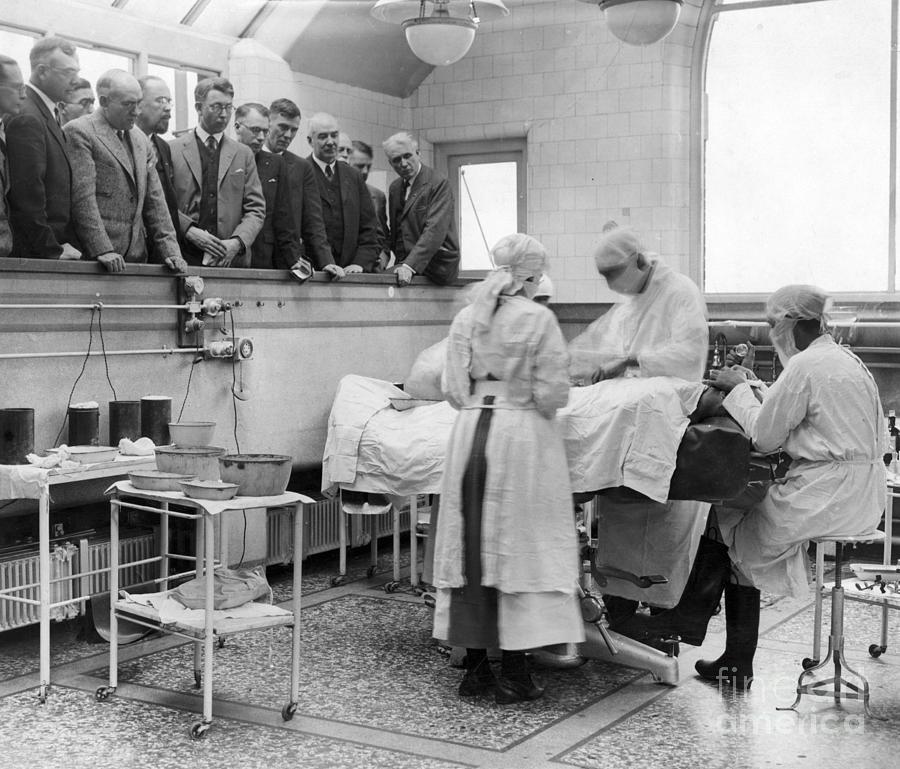 Doctors Watching Surgery In Tottenham Photograph by Bettmann