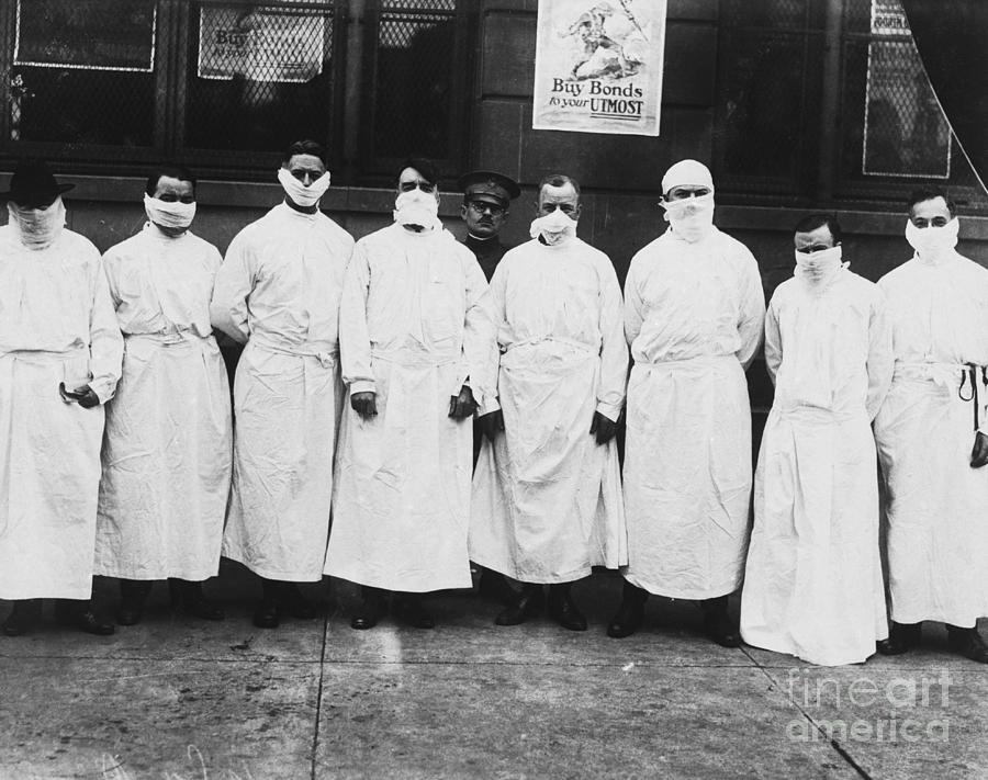 Doctors Wear Surgical Gowns And Masks Photograph by Bettmann