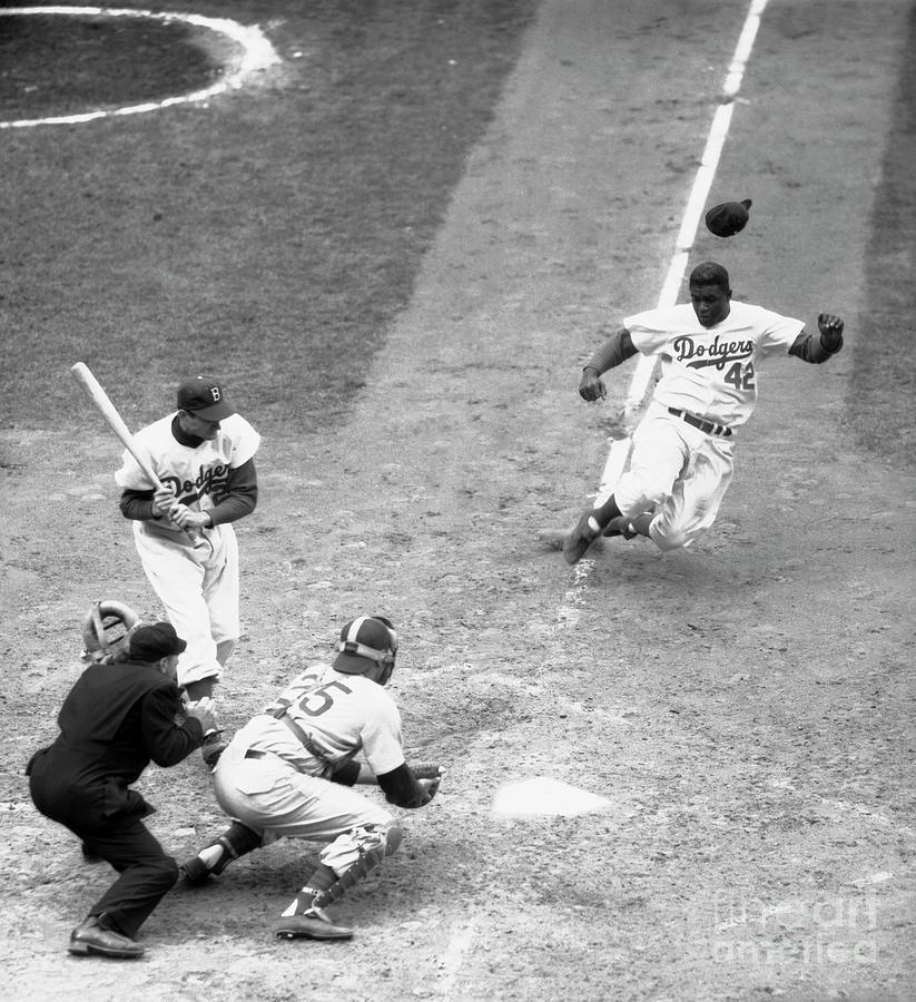Dodger Jackie Robinson Stealing Home Photograph by Bettmann