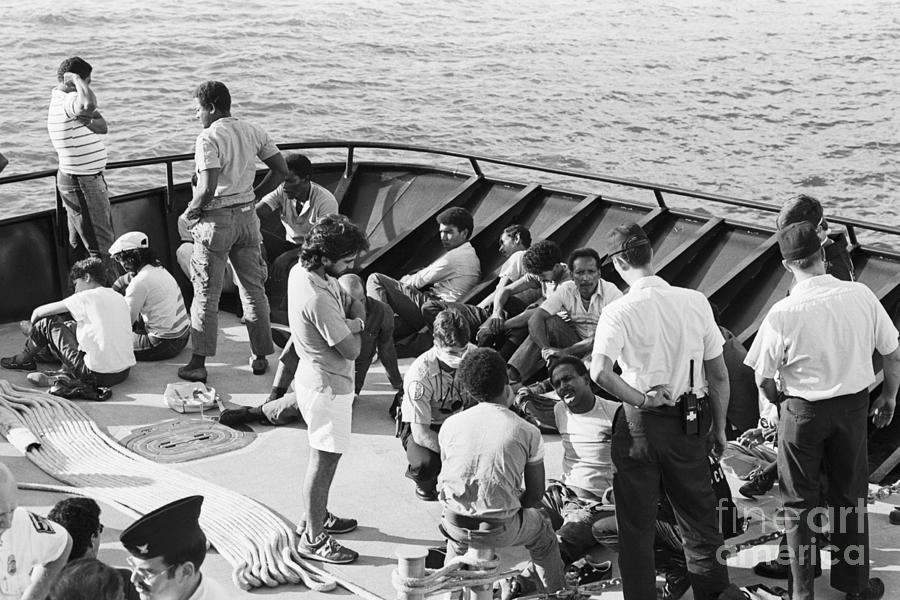 Dominican Refugees Resting On Ship Deck Photograph by Bettmann