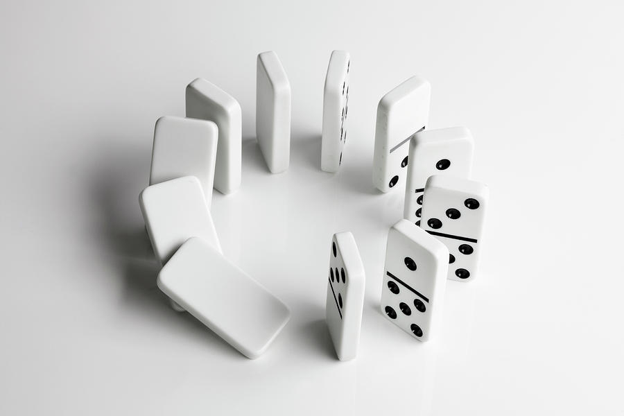 Dominoes In A Circle Beginning To Fall Photograph by Larry Washburn