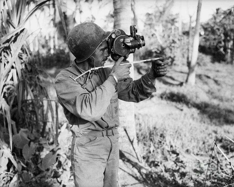 Don Senick Taking Newsreel Footage Photograph by Bettmann