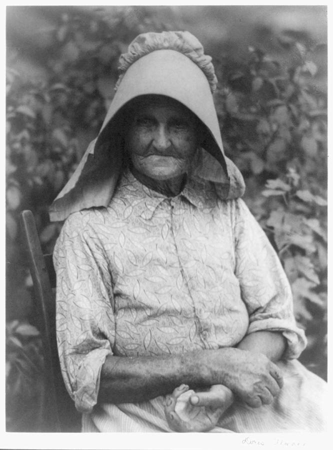 Doris Ulmann  1882-1934 , Woman In Printed Dress And Sunbonnet Painting