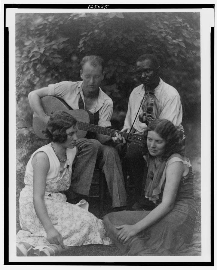 Family Painting - Doris Ulmann   1882-1934  Four Musicians Including A Man Playing A Guitar, A Man Playing A Violin by Doris Ulmann