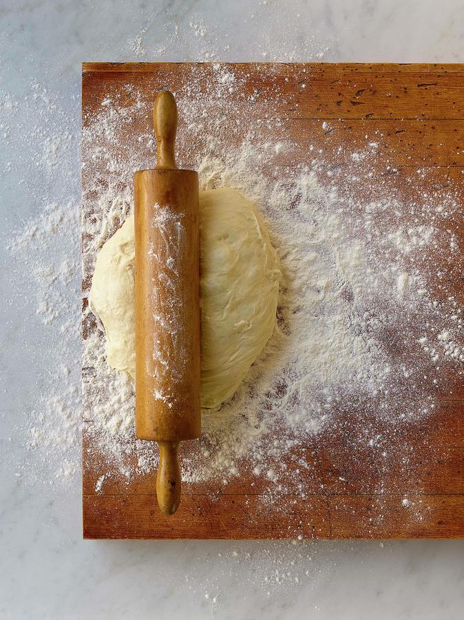 Dough On Cutting Board Photograph by Brian Macdonald