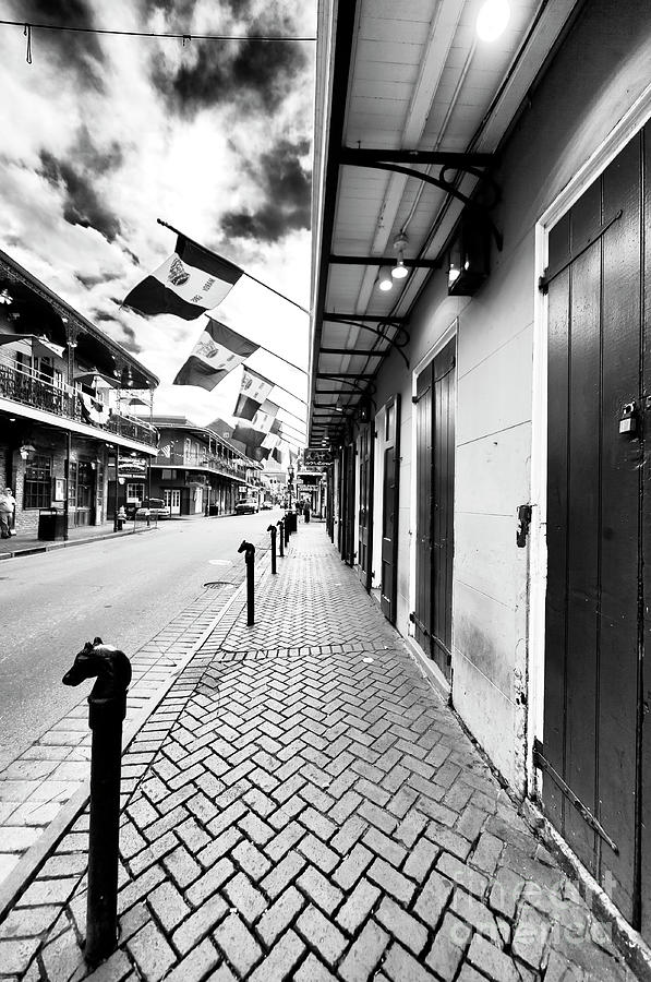 Bourbon Street Photograph - Down Bourbon Street New Orleans by John Rizzuto