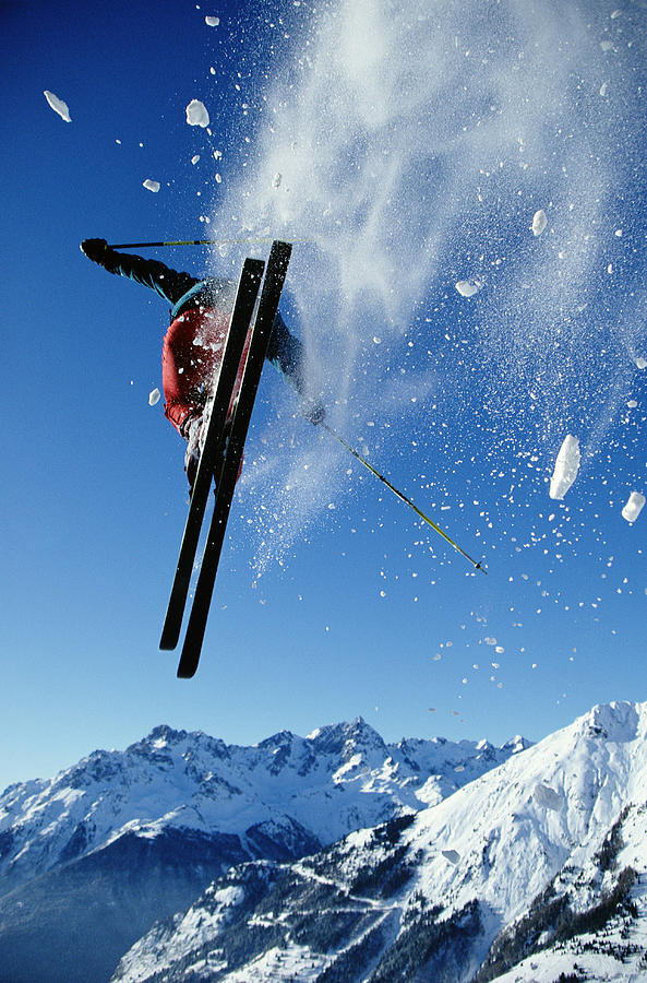 Downhill Skier In Mid-air, Rear View Photograph by Ross Woodhall