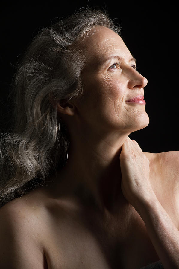 Dramatic Portrait Of Mid-aged Woman Photograph by Leland Bobbe
