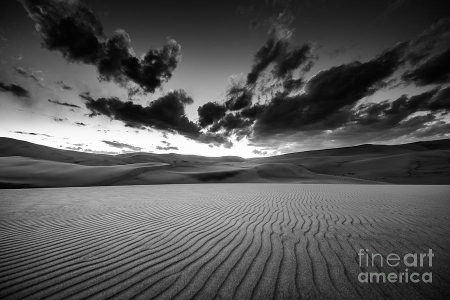Beauty Photograph - Dramatic Sky Over Desert Dunes Black by Kris Wiktor