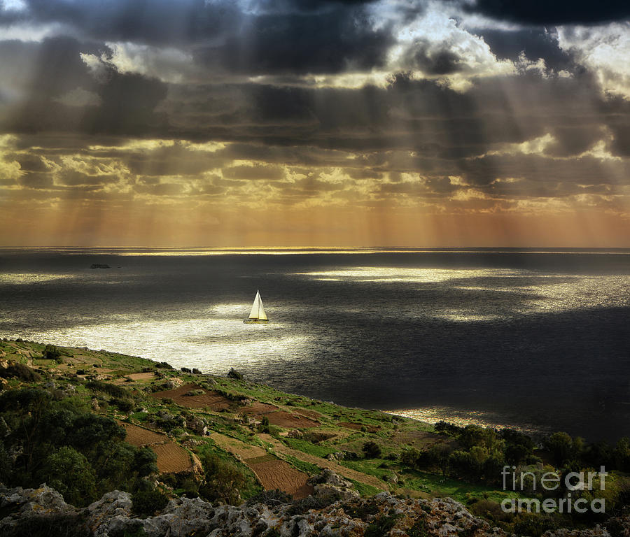 Dramatic sunset with sun rays over sea at Dingli cliffs by Stephan Grixti