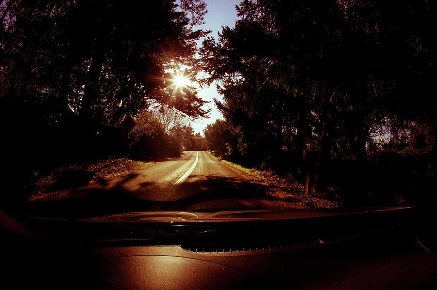 driving on the winding road to santa cruz while the sun in shini by Kim Vermaat
