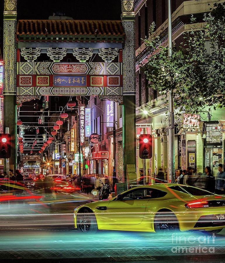 Driving through Chinatown  by EliteBrands Co