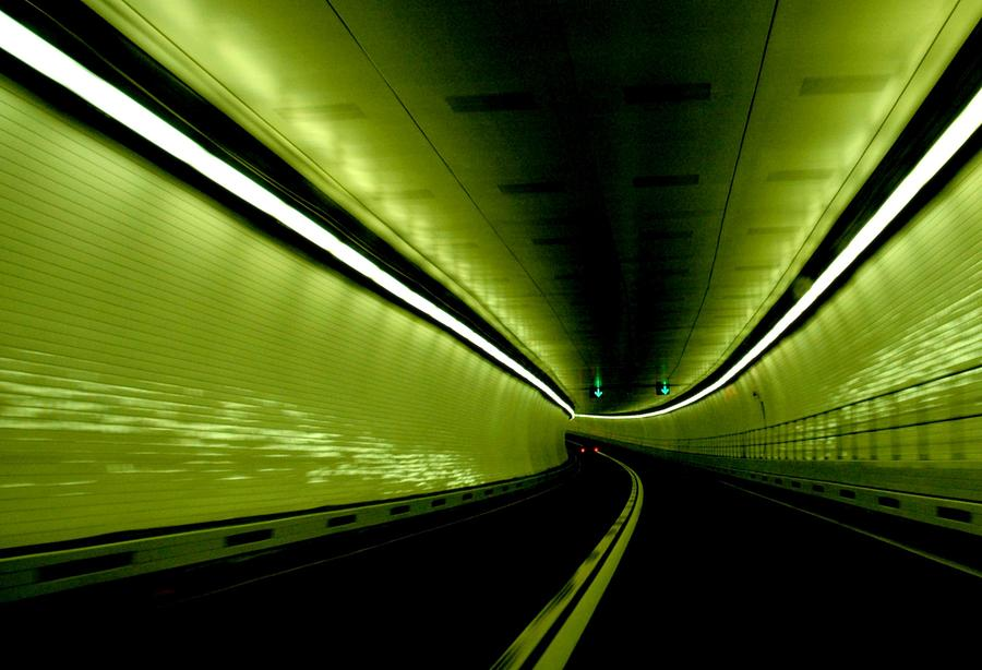 Driving Through Tunnel Lit By Green Photograph by Ralph Nardell