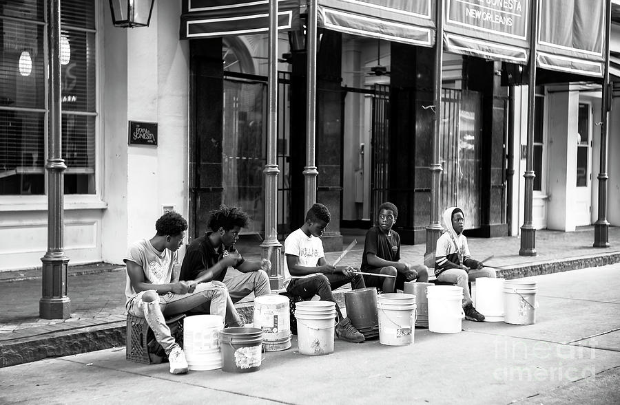 Drumming on Bourbon Street New Orleans by John Rizzuto
