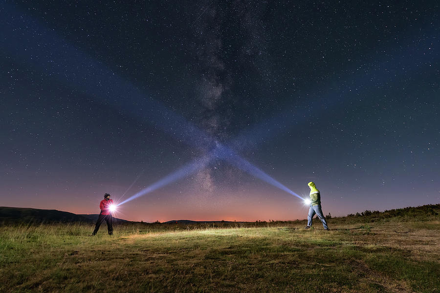 Duel Of Light Photograph by Carlos Fernandez