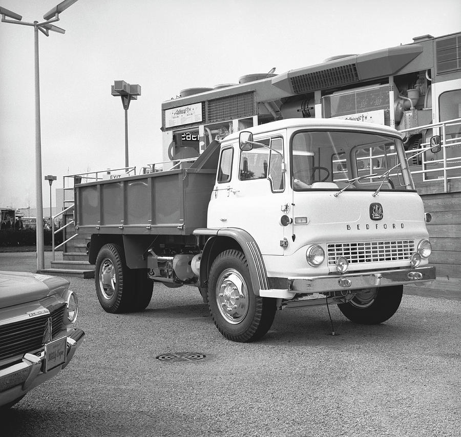 Dump Truck On Parking Lot, B&w Photograph by George Marks