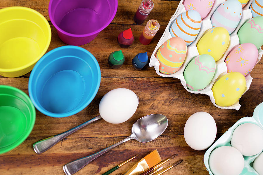 Easter Eggs Being Decorated On Wooden Photograph by Fstop123