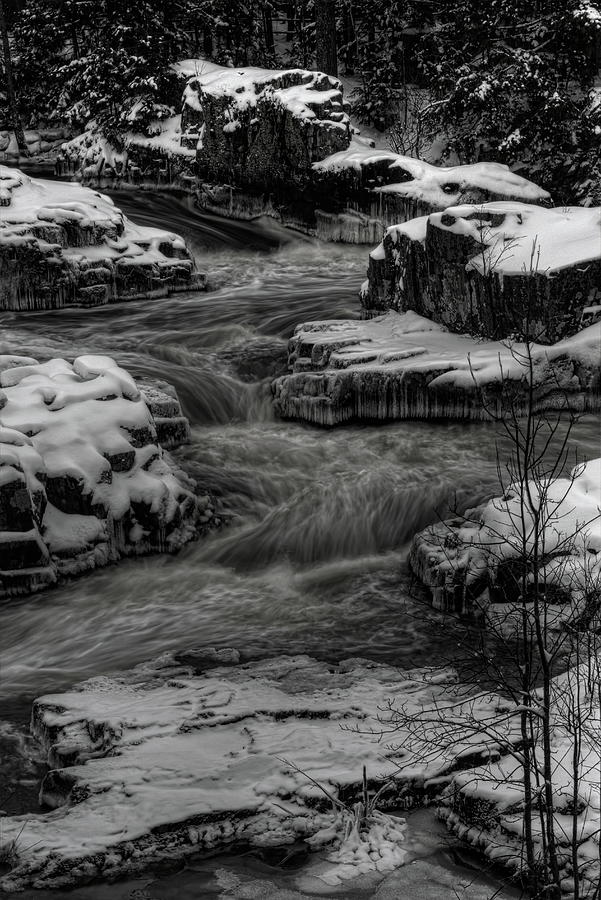 Eau Claire River Through Snow Covered Rock BW by Dale Kauzlaric