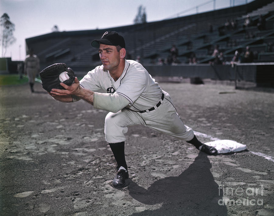 Eddie Stevens Catching A Baseball Photograph by Bettmann